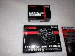 Azl z scale set, power adaptor, train controller, engine, 4 cars. Rokuhan track