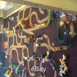Geotrax train set with tracks, bridges, buildings, engines, cars, and remote