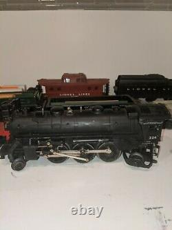 LIONEL TRAIN SET WITH ENGINE #224 with carts and case