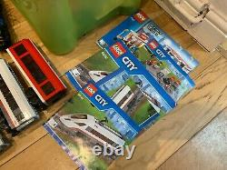 Lego trainsets joblot including station, multiple trains, approx 180 track parts