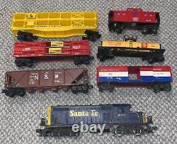 Vintage lionel electric train set including trains tracks and controls
